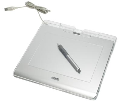 An antiquated looking silver drawing tablet with a pen resting on top and a USB cable extending from the top-left corner.